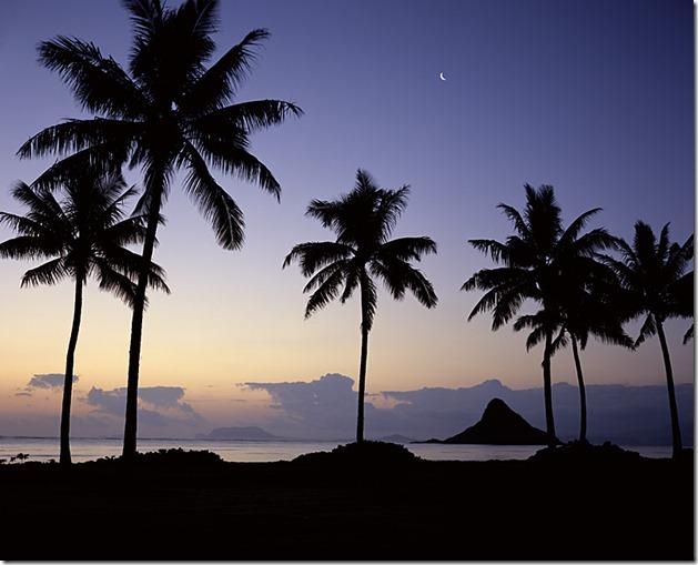 Moonrise over Chinaman's Hat. Kualoa Regional Park, Oahu, Hawaii.